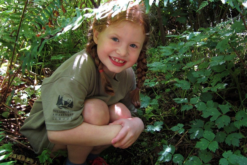 Finding a 'sit spot' in a grove of shrubbery is an integral part of camp at Anake Wilderness Awareness School. Image courtesy AWAS.
