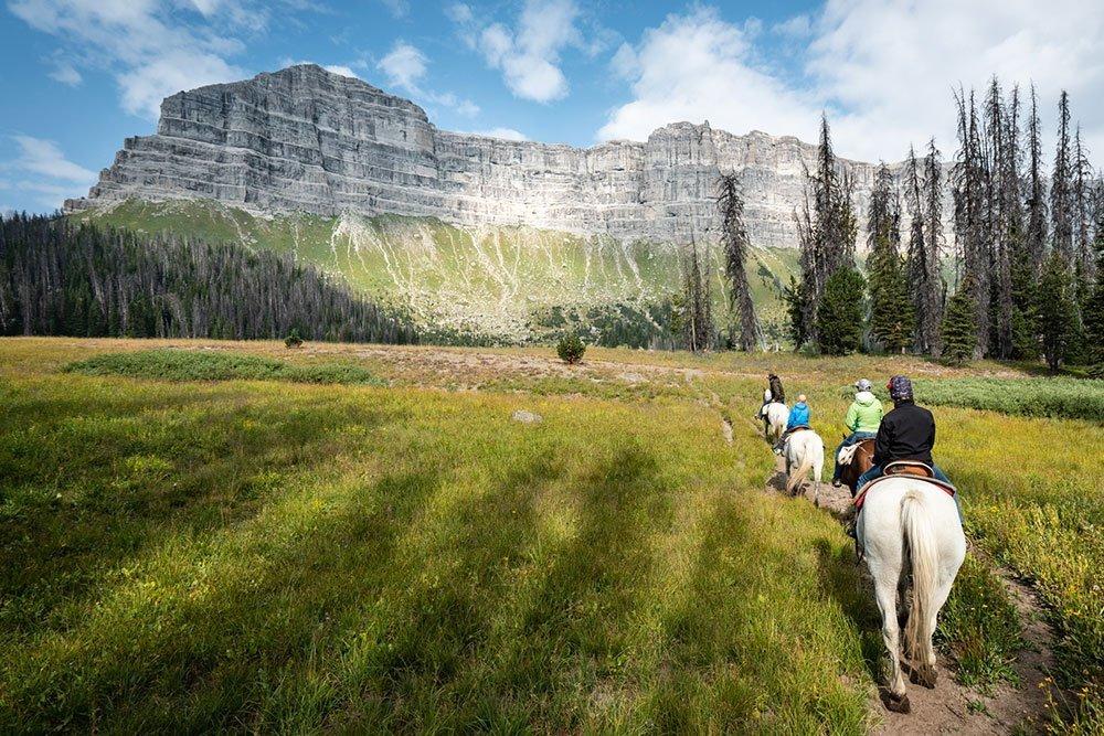 horseback riding wyoming rocky mountains